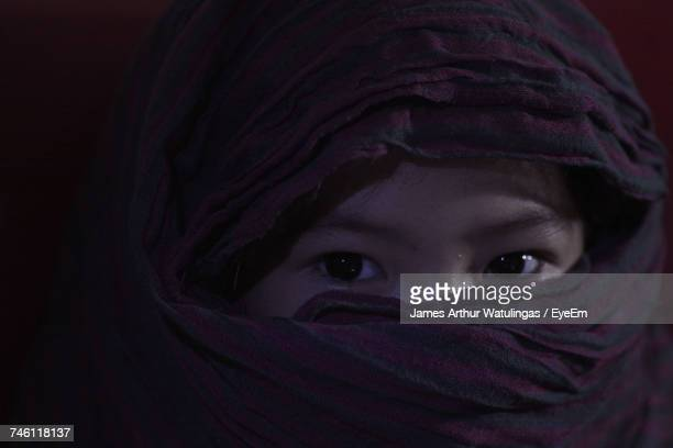 Portrait Of Girl Face Covered With Scarf