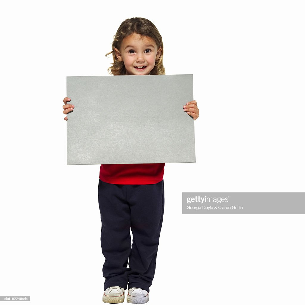 Portrait of girl (4-5) holding blank card : Stock Photo