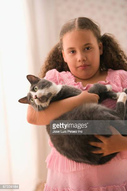 Portrait of girl holding cat