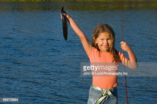 Girl holding fish stock photos and pictures getty images for Girl fishing pole