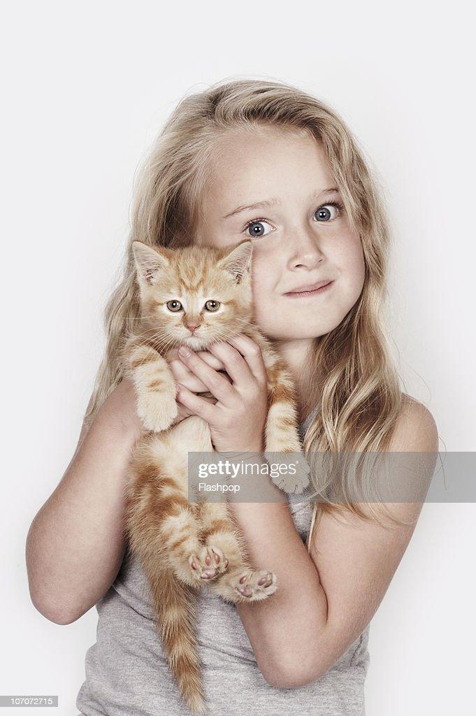 Portrait of girl hugging her pet cat : Stock Photo