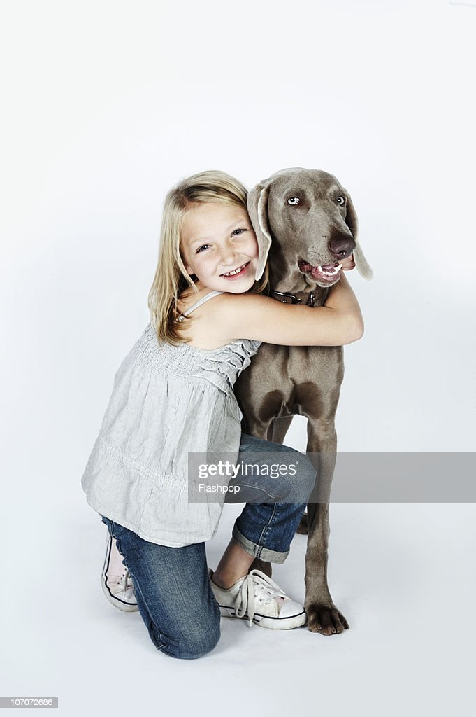 Portrait of girl hugging her pet dog : Stock Photo