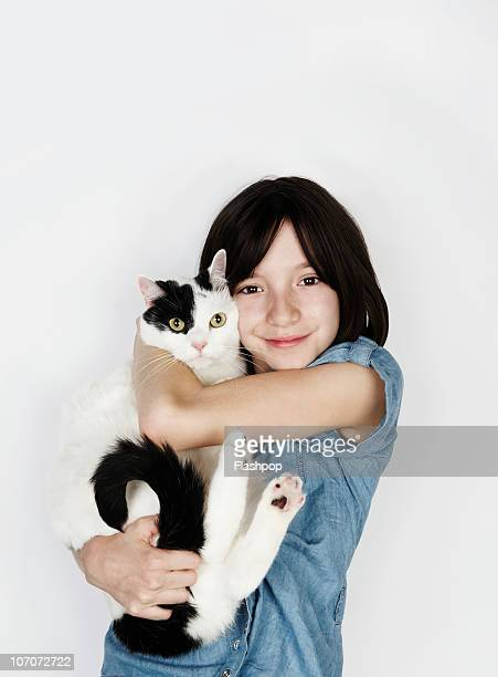 Portrait of girl hugging pet cat