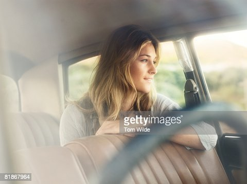 Portrait of girl in a car