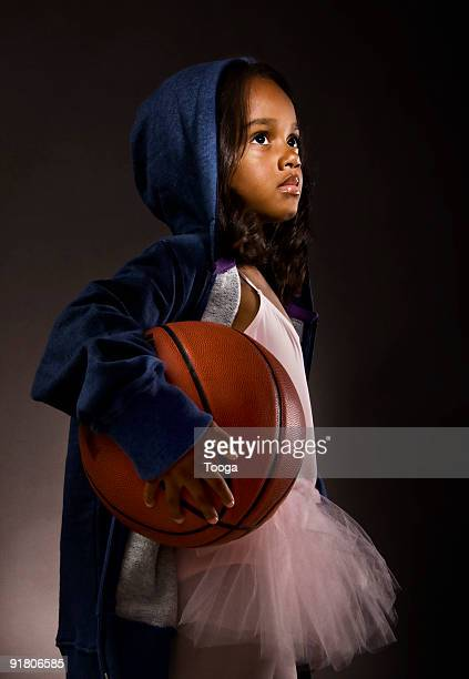 Portrait of girl in ballet outfit with basketball