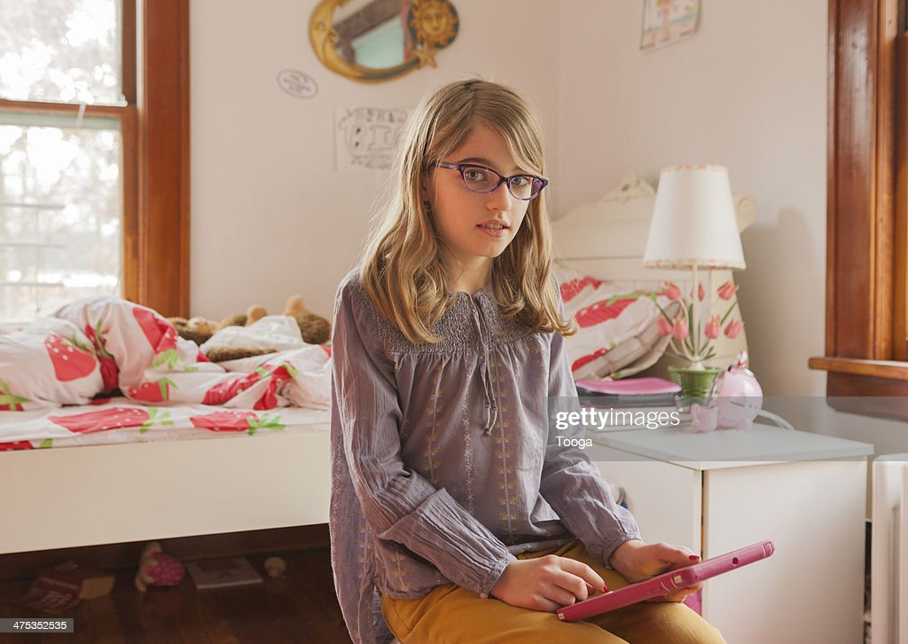 Portrait of girl in bedroom with technology : Stock Photo