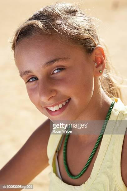 Portrait of girl (12-13) in sleeveless top, smiling