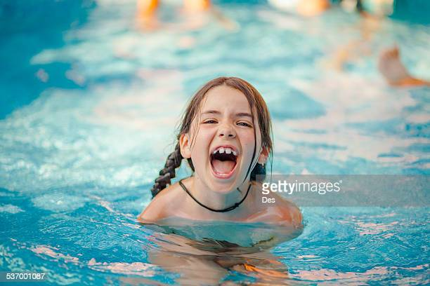 Portrait of girl in swimming pool shouting