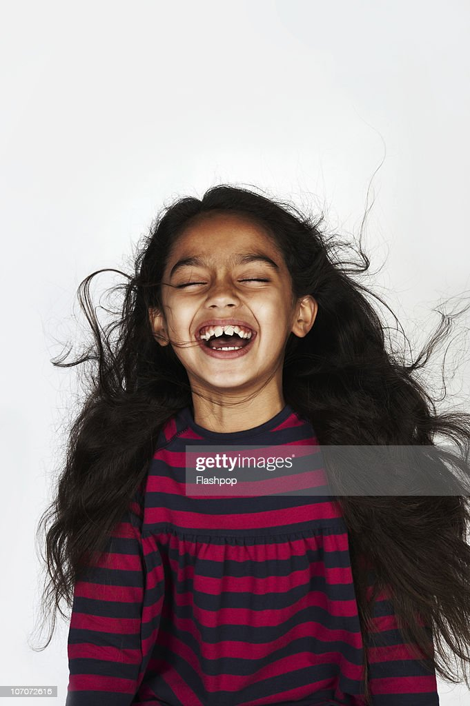 Portrait of girl laughing : Stock Photo