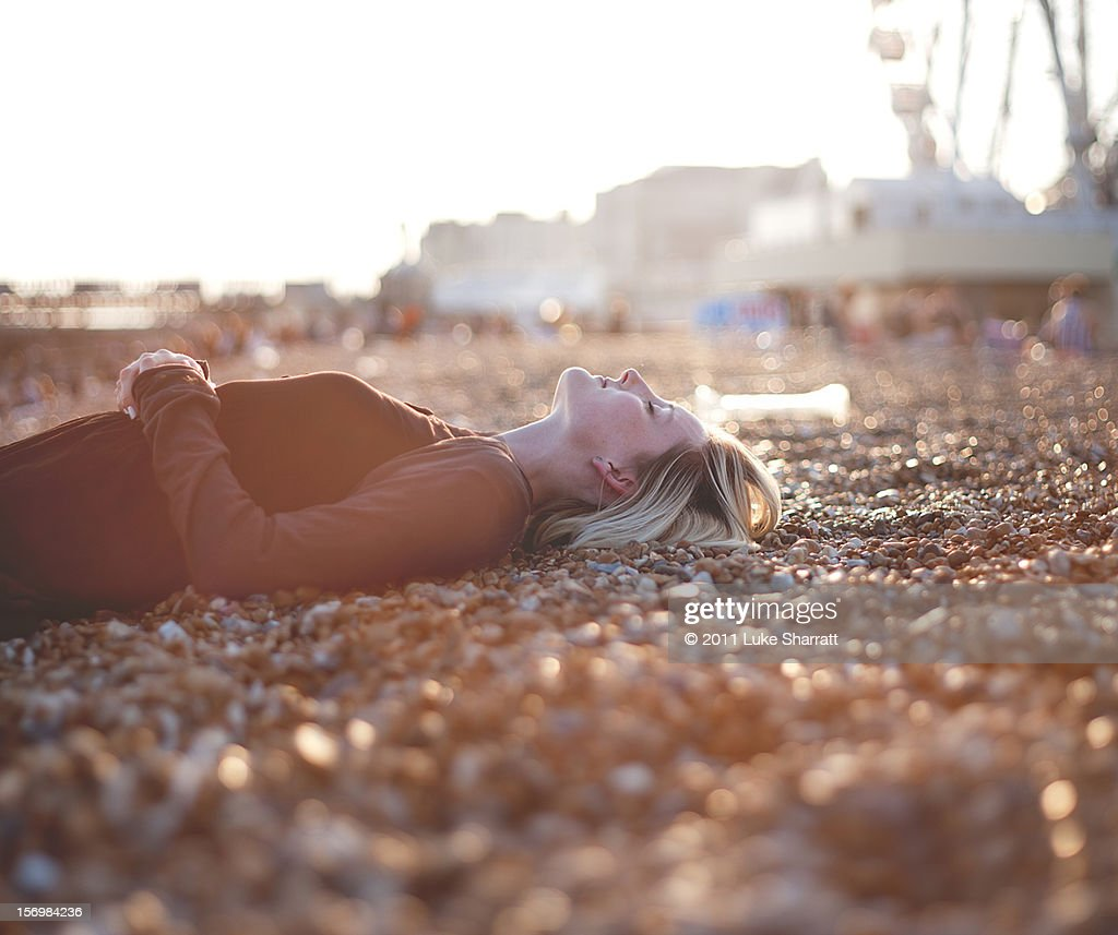 portrait of girl lying on beach : Stock Photo