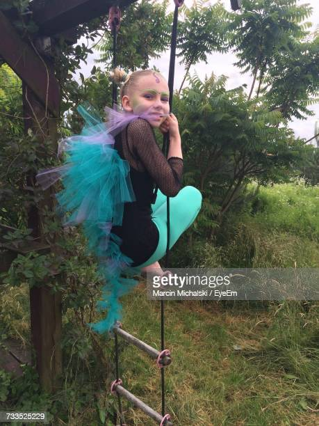 Portrait Of Girl On Rope Ladder