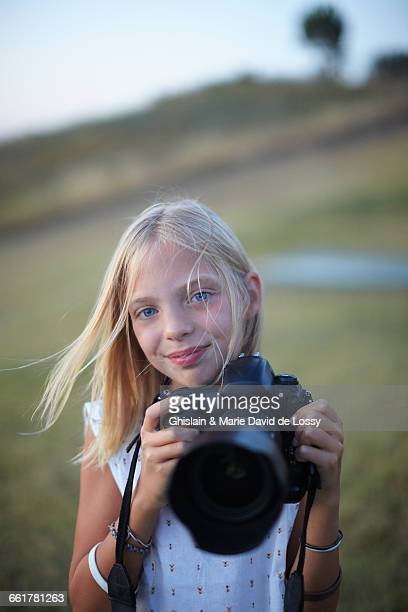 Portrait of girl photographing with digital slr, Buonconvento, Tuscany, Italy