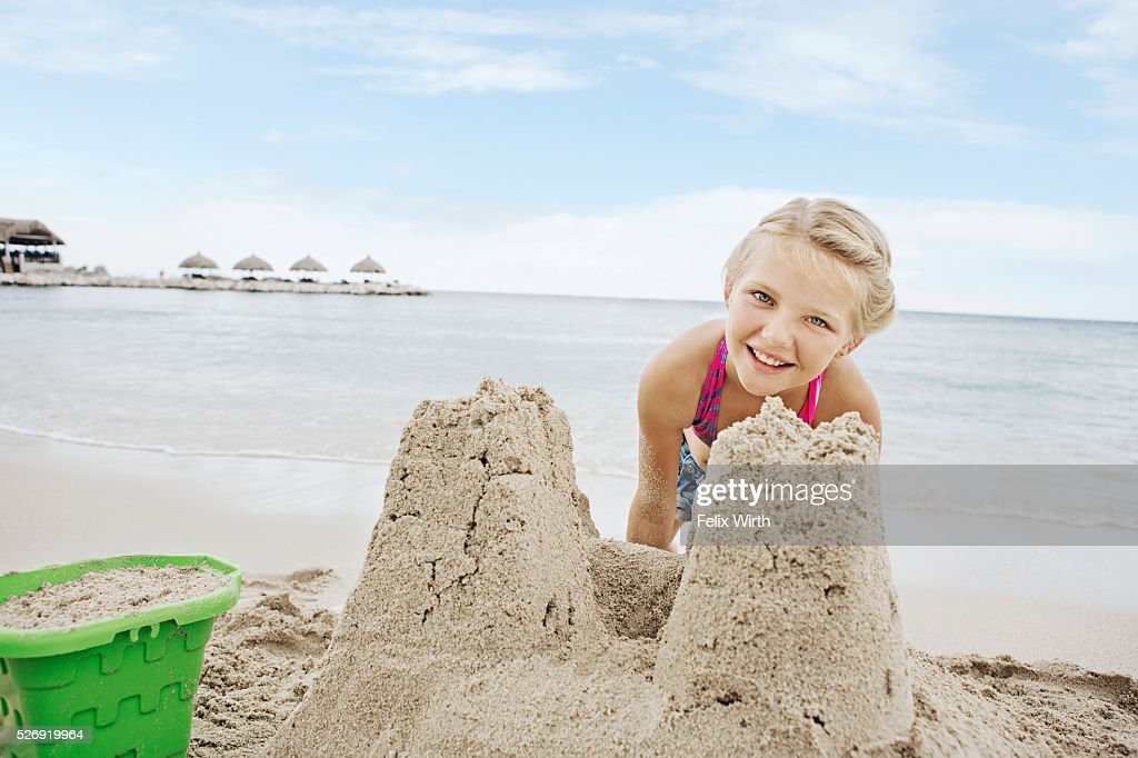 Portrait of girl (10-12) playing on beach in sand : Stock-Foto