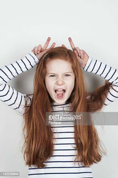 Portrait of girl pulling a funny face