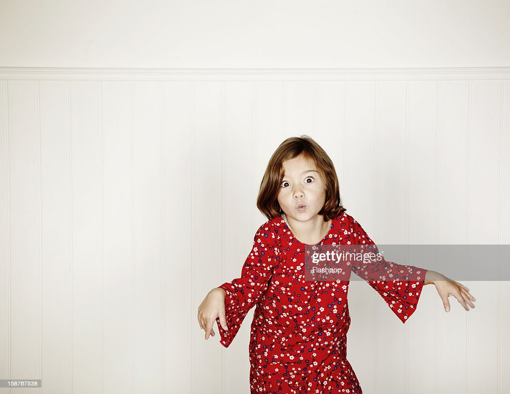 Portrait of girl pulling funny faces : Stock Photo