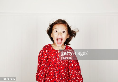 Portrait of girl pulling funny faces