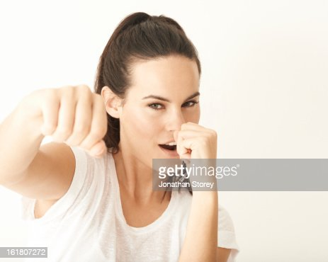 Portrait of girl punching towards the camera