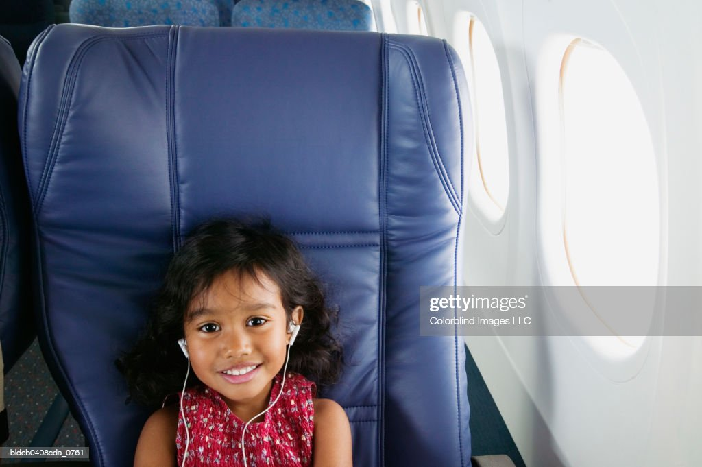 Portrait of girl sitting in an air plane