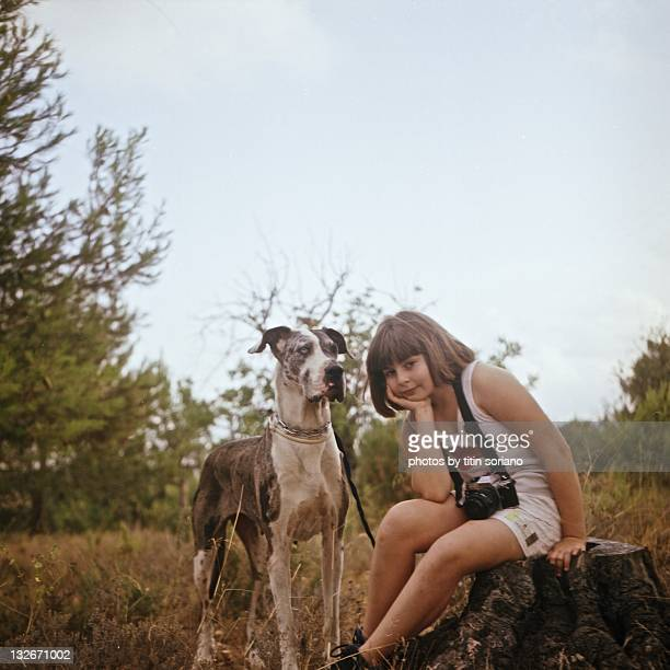 Portrait of girl sitting with dog