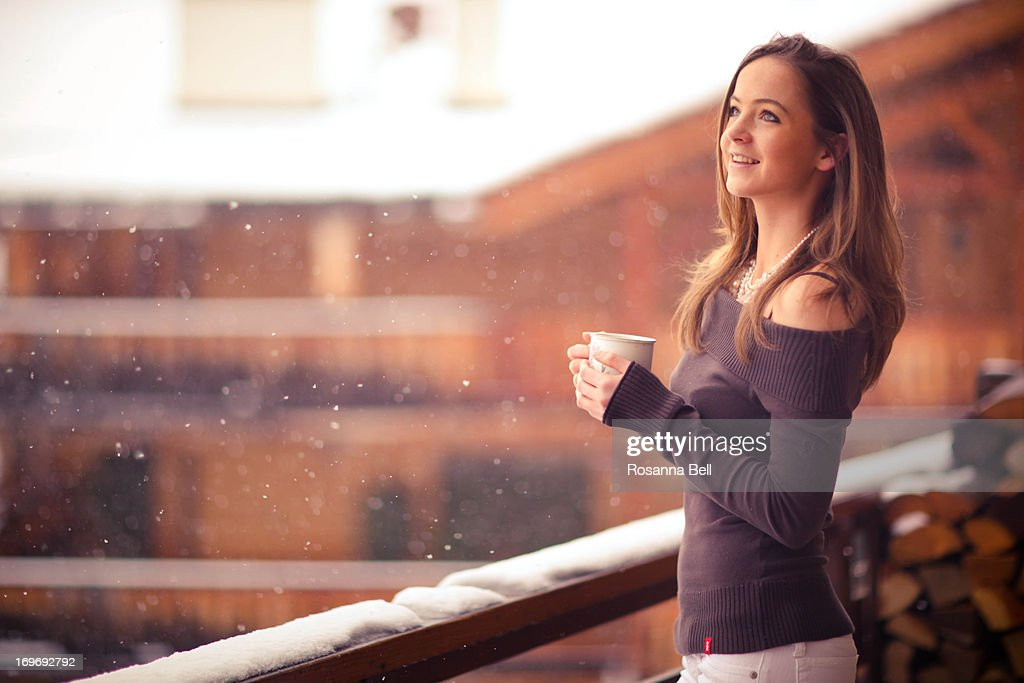 Portrait of Girl Smiling in the snow on balcony