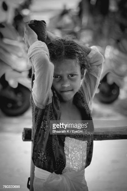 Portrait Of Girl Standing By Pole