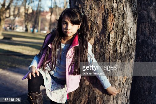 Portrait of girl standing near tree : Stock Photo