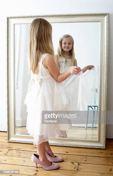 Portrait of girl wearing her mother's shoes