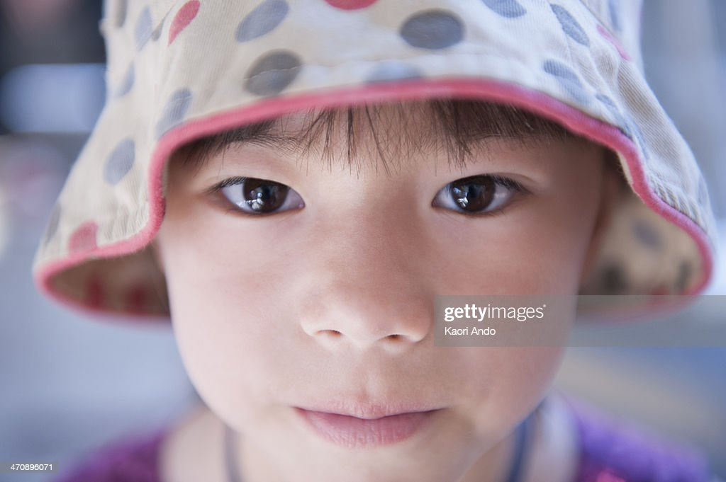 Portrait of girl wearing spotty beanie hat : Stock Photo