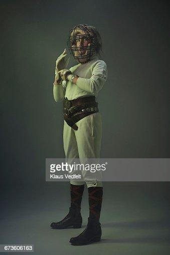 Portrait of girl wearing vintage baseball mask