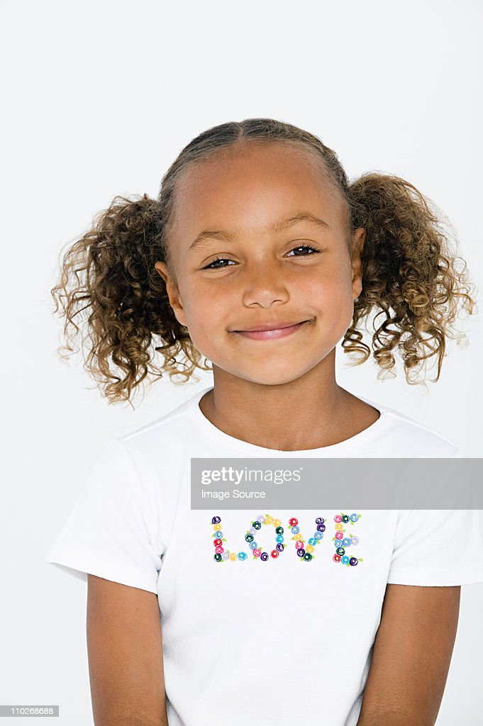 Portrait of girl wearing white t shirt with love written on it : Stock Photo