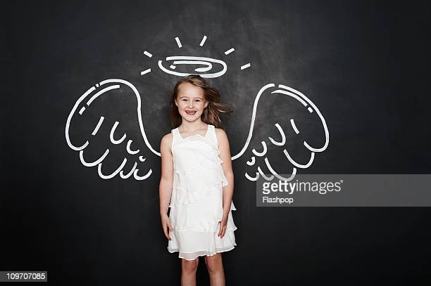 Portrait of girl with angel wings and halo