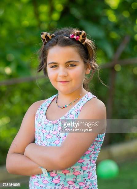 Portrait Of Girl With Arms Crossed Standing At Park