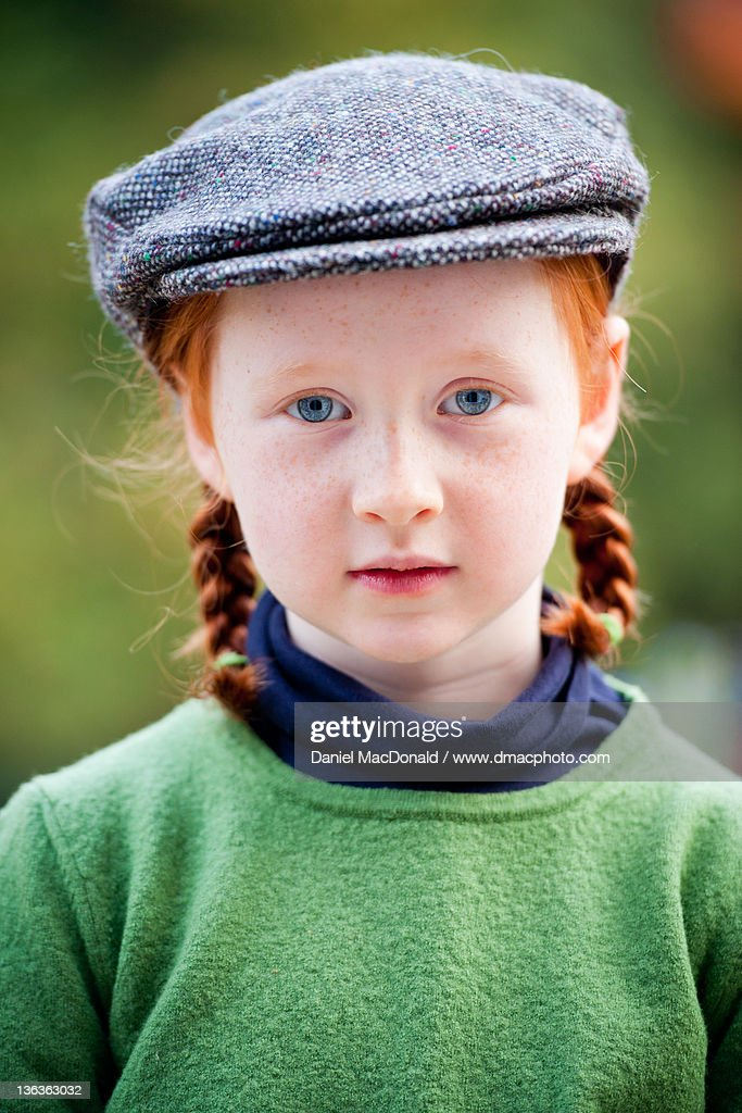 Portrait of girl with braids and flat cap