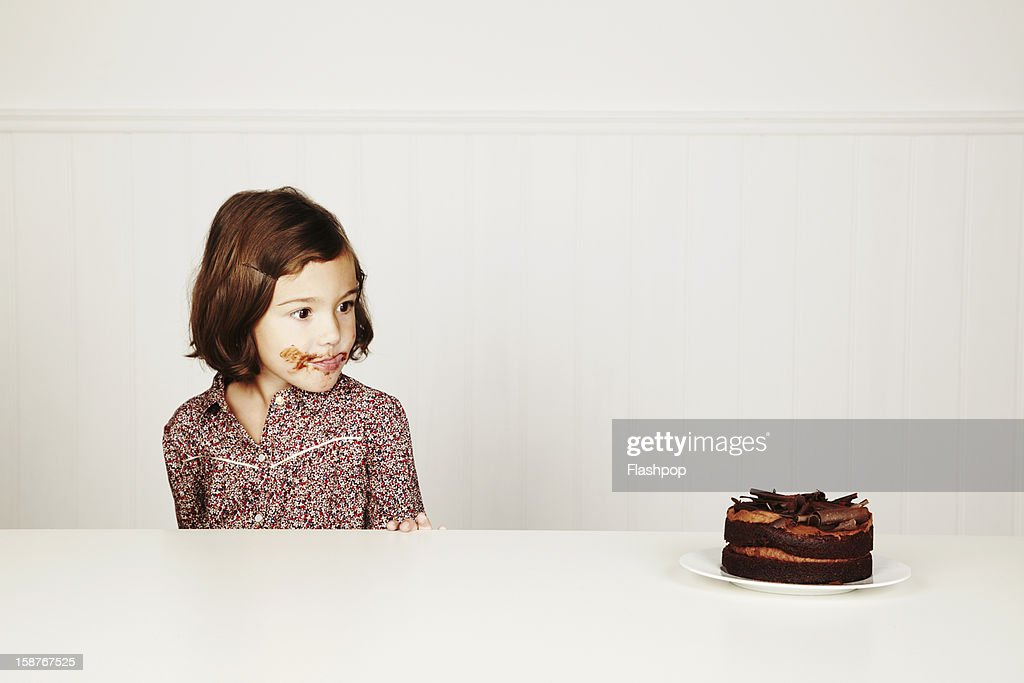 Portrait of girl with chocolate cake : Stock Photo
