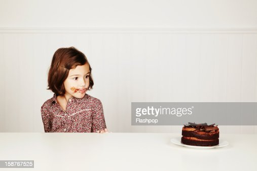 Portrait of girl with chocolate cake : Bildbanksbilder