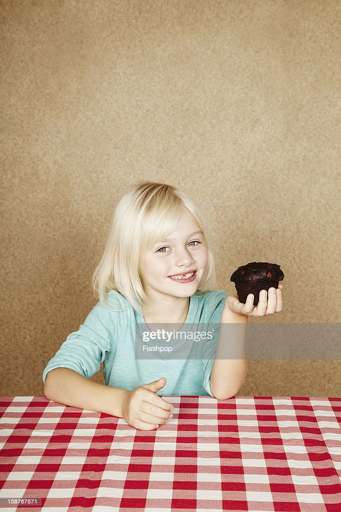 Portrait of girl with chocolate cup cake : Stock Photo