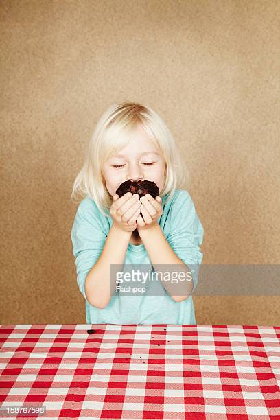 Portrait of girl with chocolate cup cake