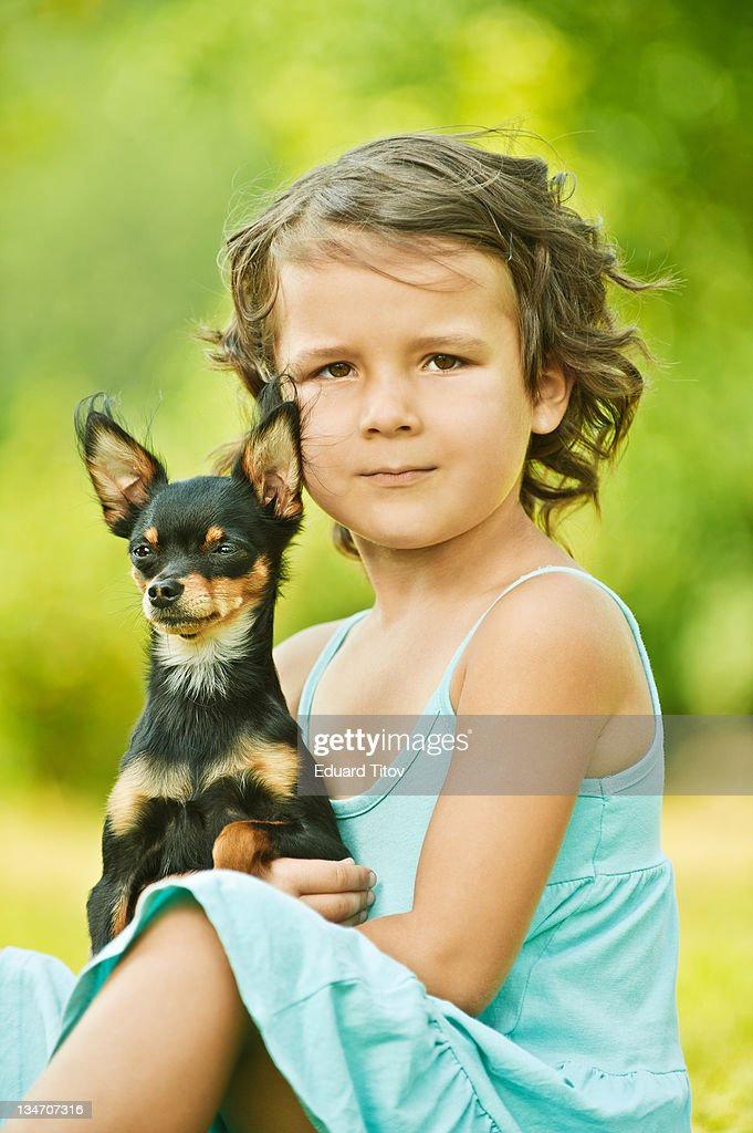 Portrait of girl with dog : Stock Photo