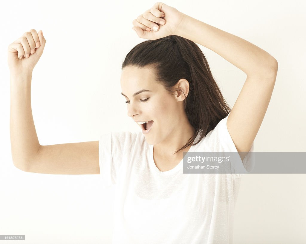 Portrait of girl with hands abover her head, danci : Stock Photo