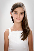 Portrait of girl (8-9 years) with long brown hair