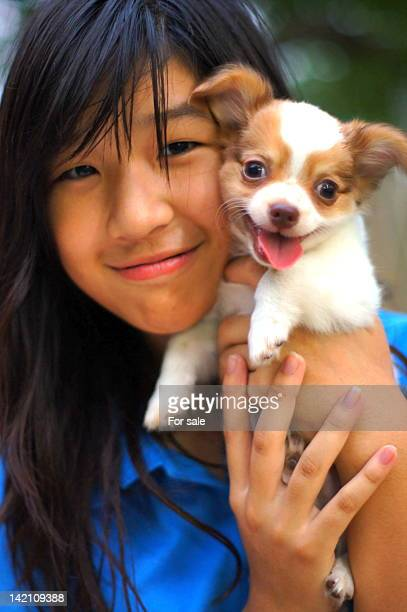 Portrait of girl with puppy