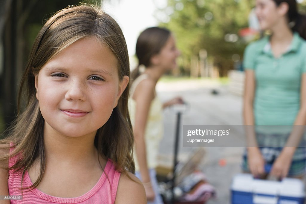 Portrait of girl with sisters : Stock Photo