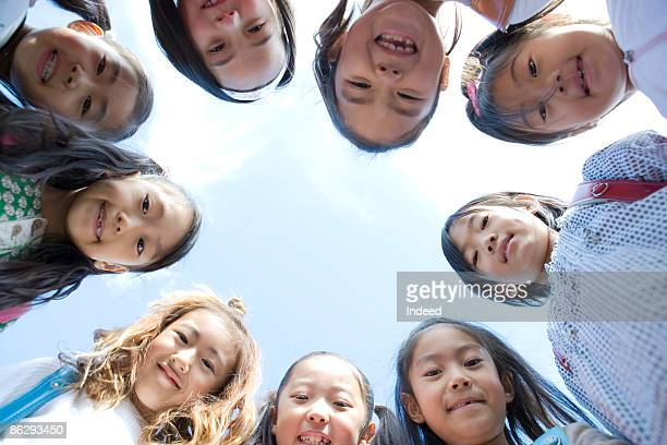 Portrait of girls in huddle, smiling