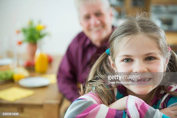 Portrait of granddaughter and grandfather, smiling