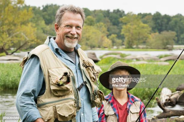 Portrait of grandfather and grandson fishing