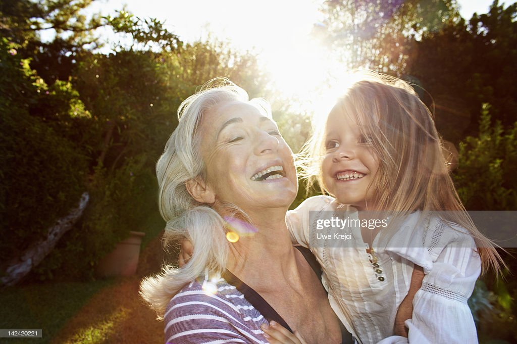 Portrait of grandmother and girl (4 - 5 y) : Stock Photo