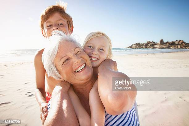 Portrait of Grandmother and grandchildren on beach