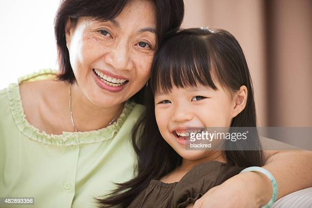 Portrait of Grandmother and Granddaughter Smiling