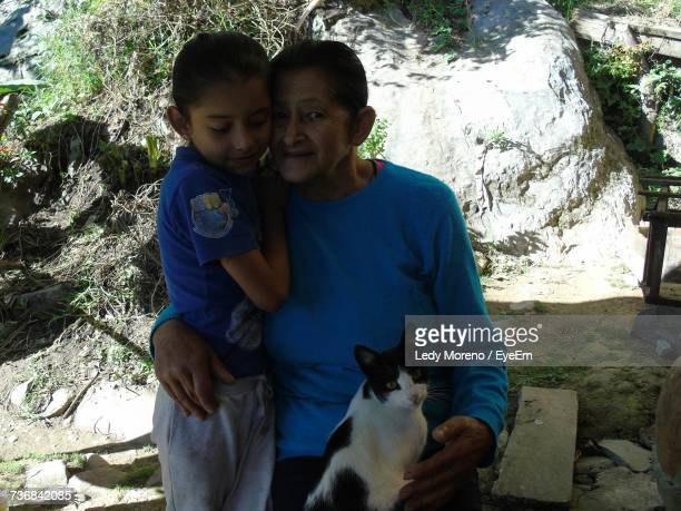 Portrait Of Grandmother With Girl And Cat