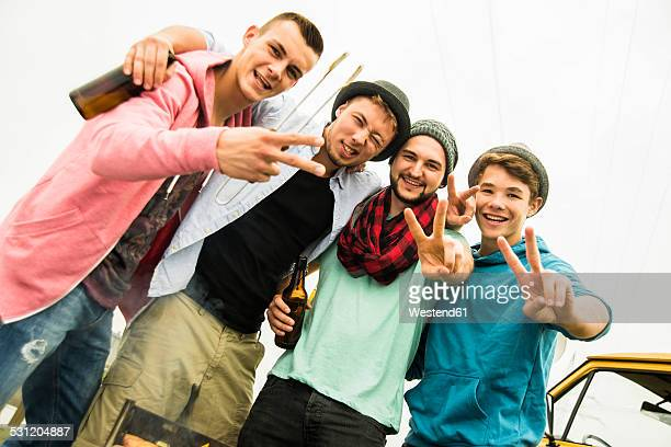 Portrait of group of friends drinking beer and having a barbecue